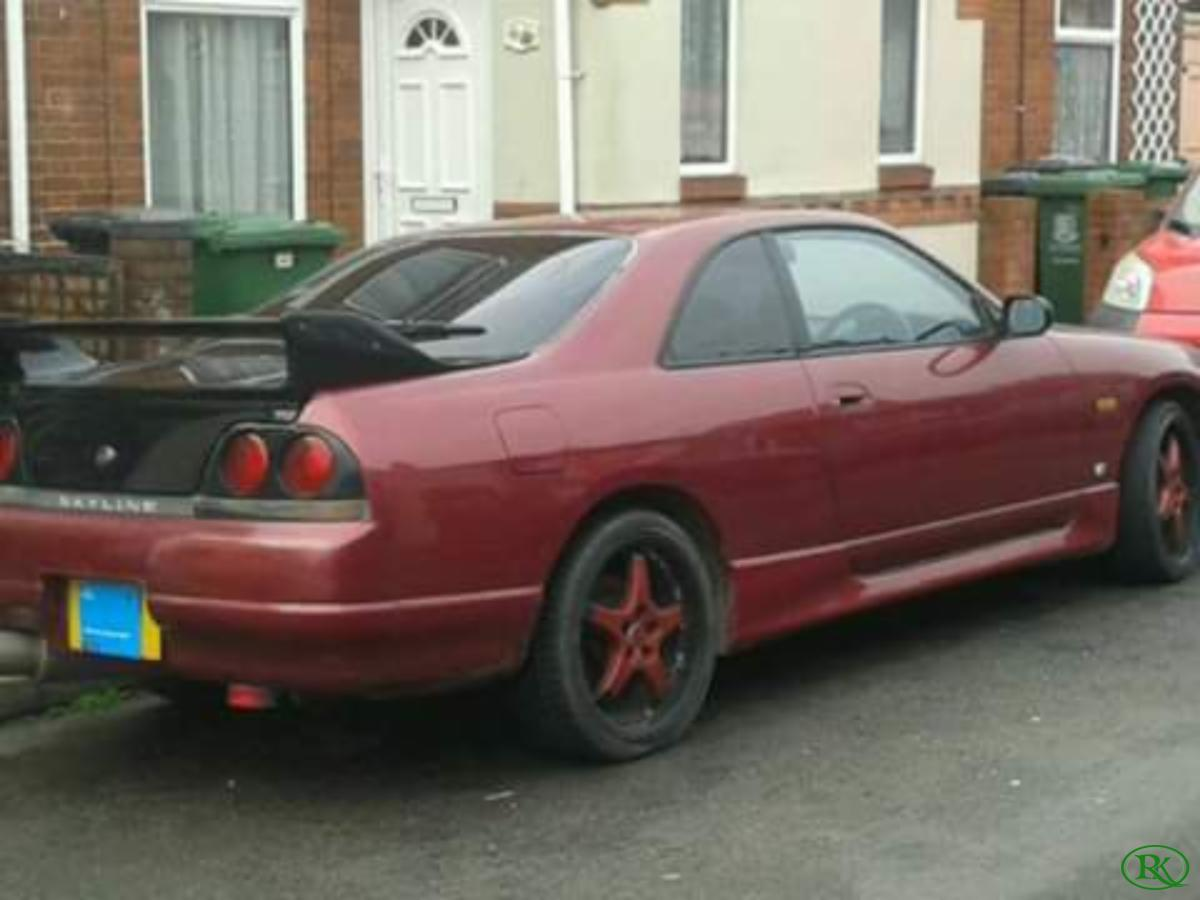 1993 nissan skyline r33 coupe super clear red