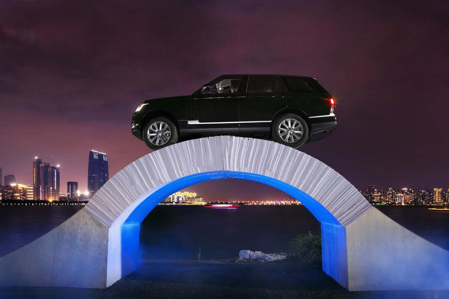 Range rover drives across paper brige