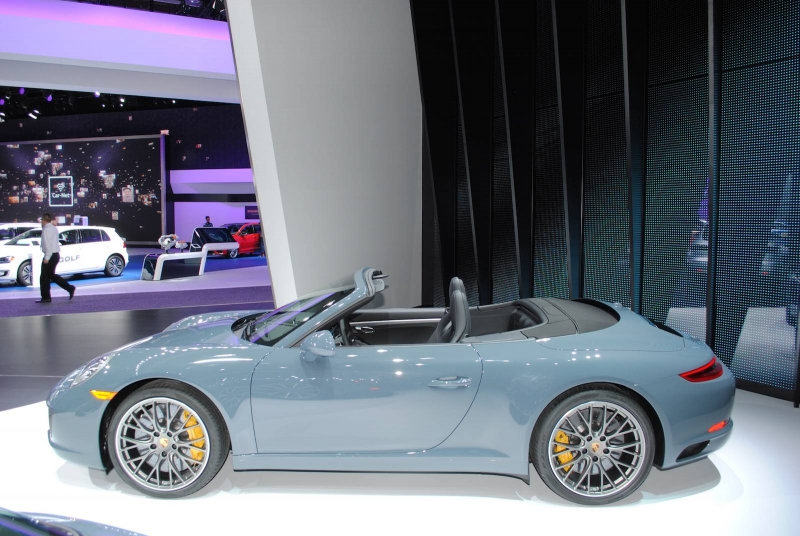 A stunning Graphite Blue Metallic Porsche 911 Carrera S Cabriolet at the Detroit Motor Show