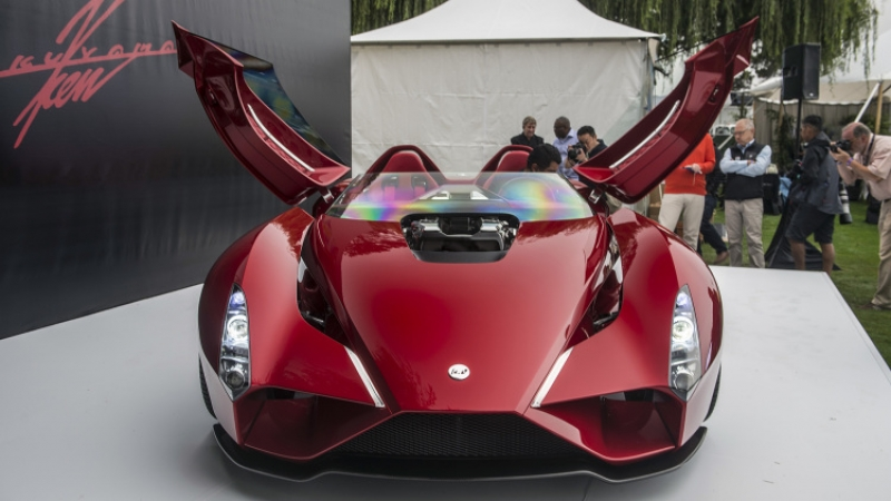 Enzo Ferrari designer stuns Monterey with a breathtaking supercar!
