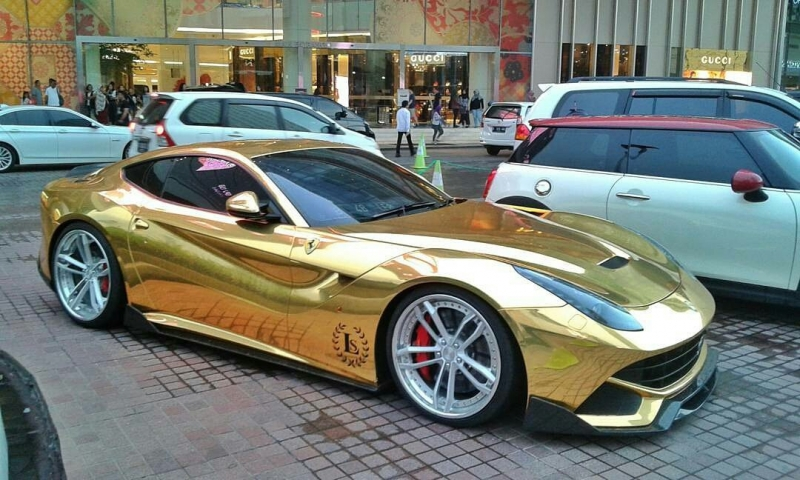 A gold wrapped Ferrari F12 turns heads for miles around in Indonesia